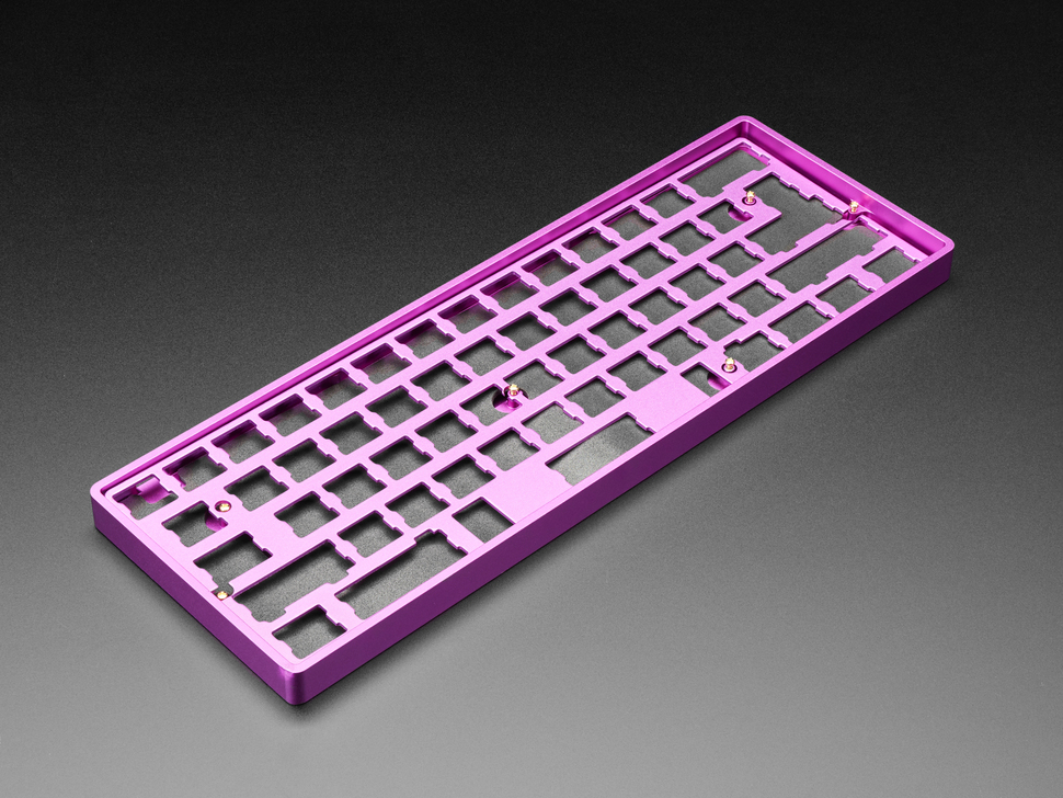 Angled shot of Anodized Purple Aluminum Metal Keyboard Plate assembled with felt padding and purple enclosure.