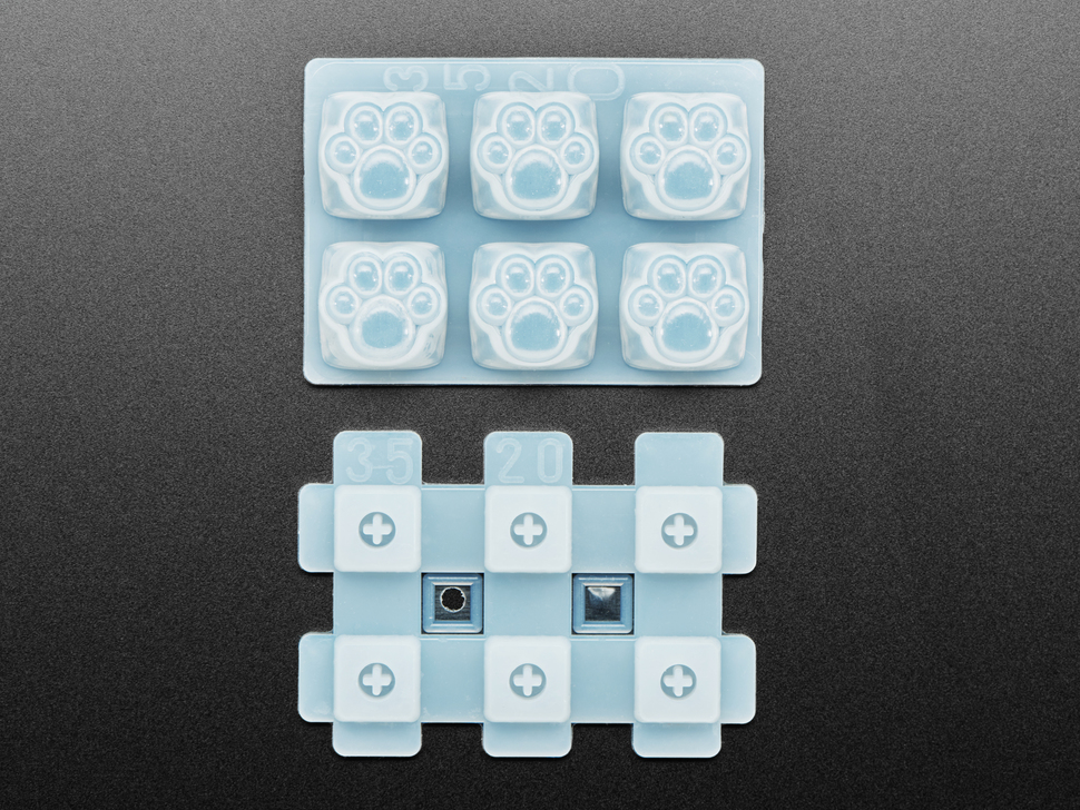 Top view of two-piece rubber kitty paw keycap molds
