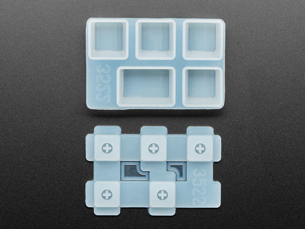 Top view of two Tab keycap molds separated.