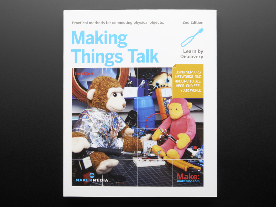 """Front cover of """"Making Things Talk, Second Edition"""" By Tom Igoe - 2nd Edition. Cover photograph features two different stuffed monkey toys tinkering with electronics."""