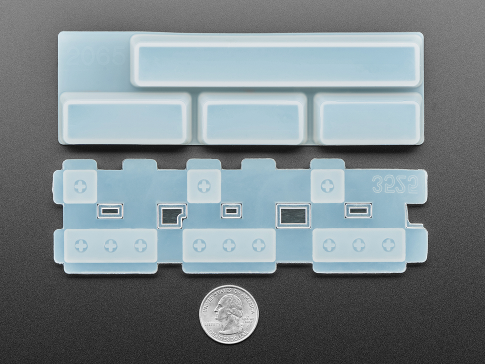 two piece Spacebar keycap mold above a US quarter for scale.