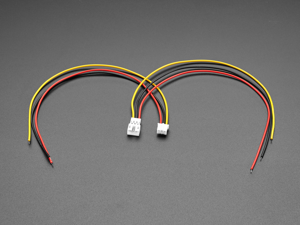 Angled shot of two 2.0mm pitch 3-pin JST PH matching cable pairs. The cables are not connected.