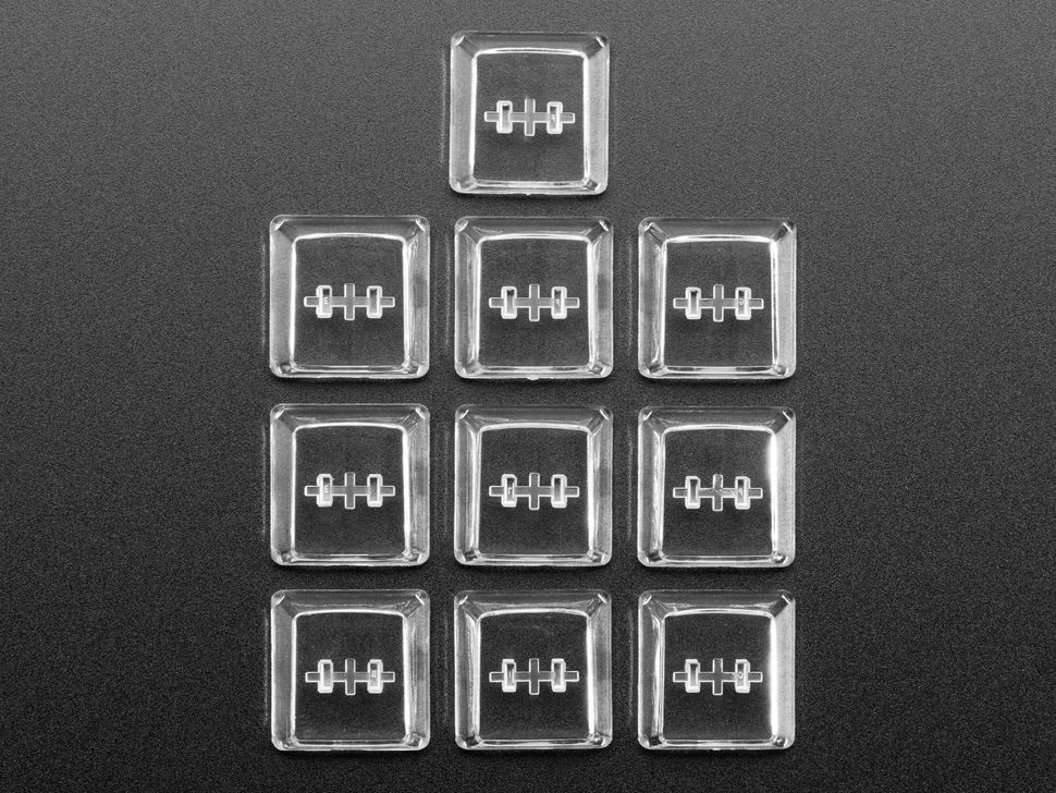 Top view of 10 clear keycaps.