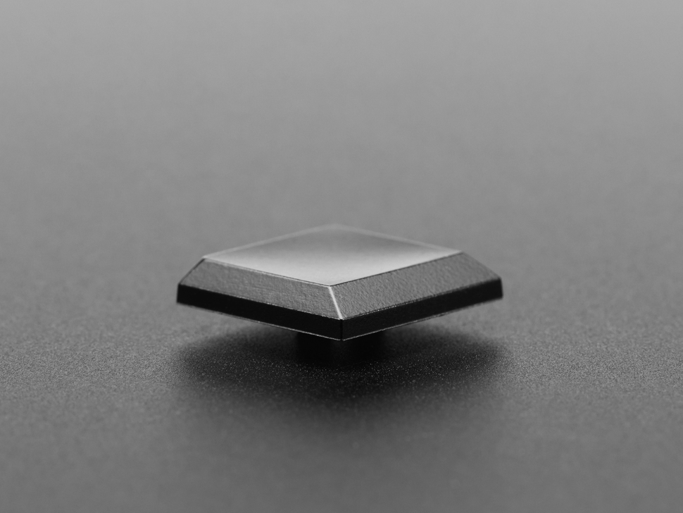 Close-up of height of single black keycap.