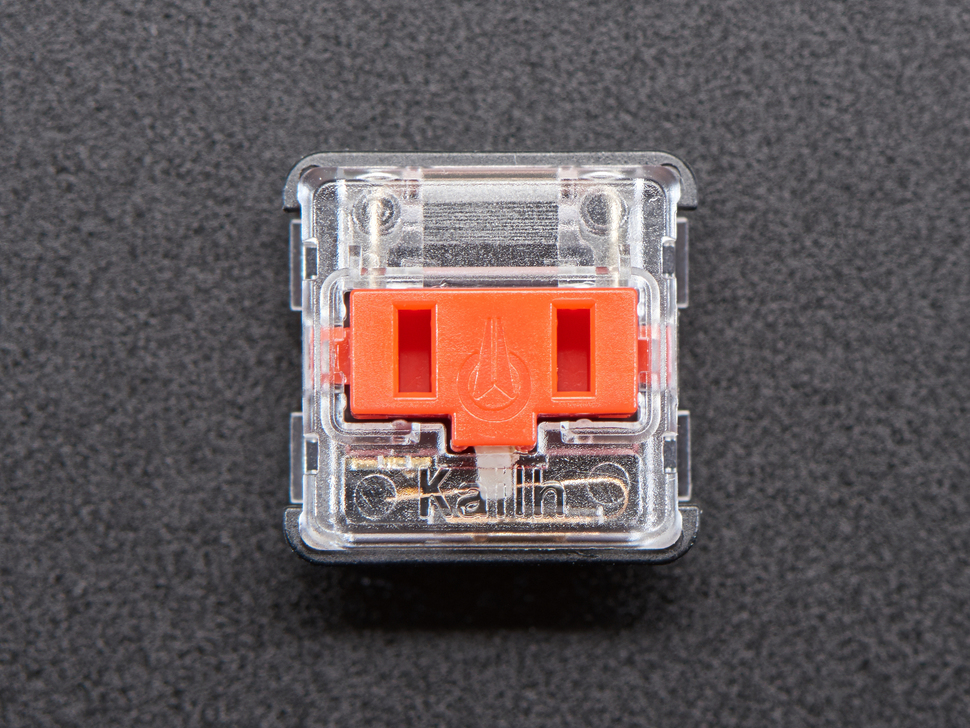 Top view of one red Kailh Choc V1 keyswitch.