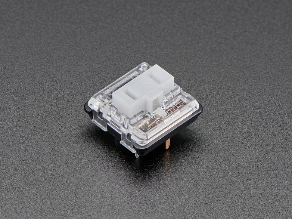 Angled shot of one white Kailh Choc V1 keycap.