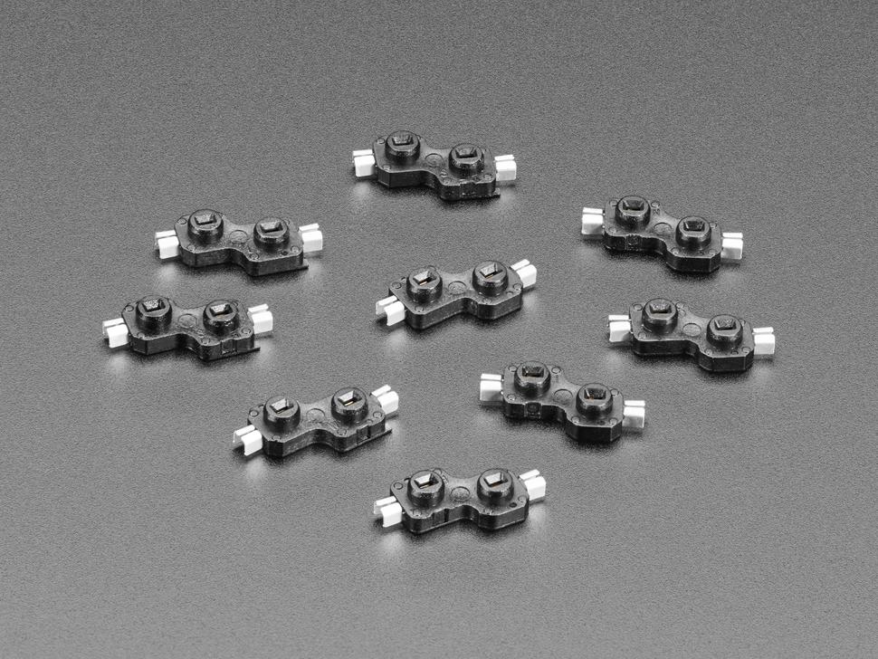 Angled shot of ten Choc switch sockets.