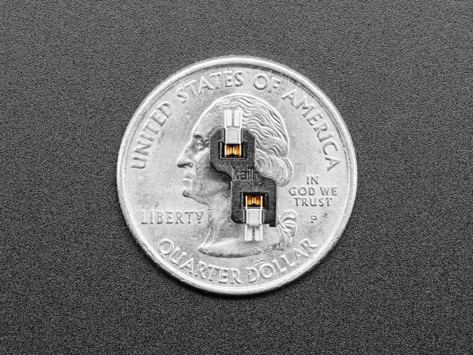 Single Choc switch socket atop a US quarter for scale.