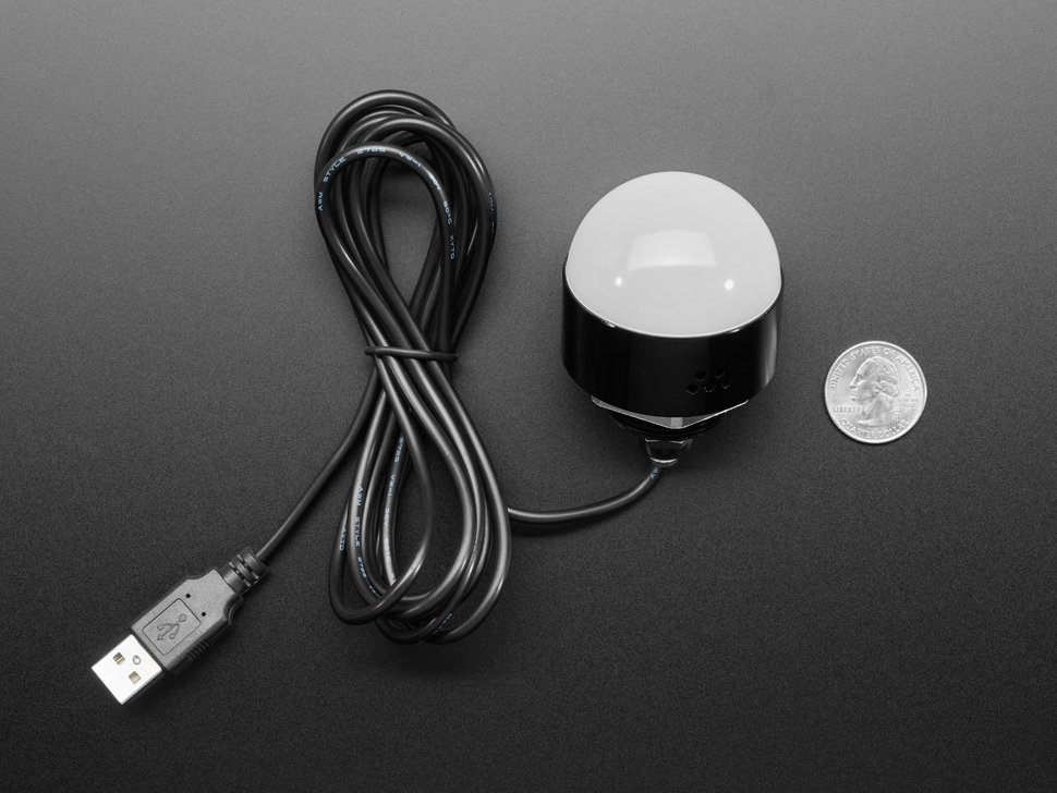Top view of USB Round Lamp with Buzzer next to US quarter for scale.