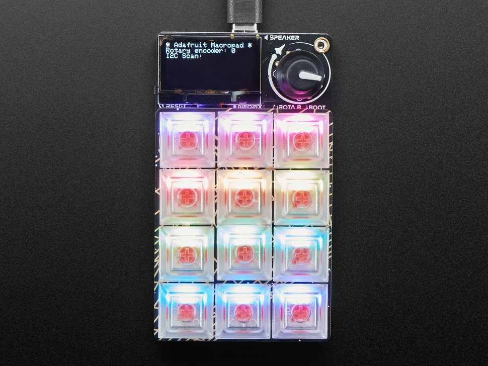Top shot of powered on, assembled MacroPal keypad glowing rainbow colors.