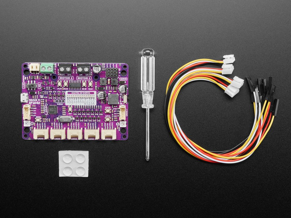 Top view of Maker Pi RP2040 board, mini screwdriver, rubber feet, and four cable assemblies.