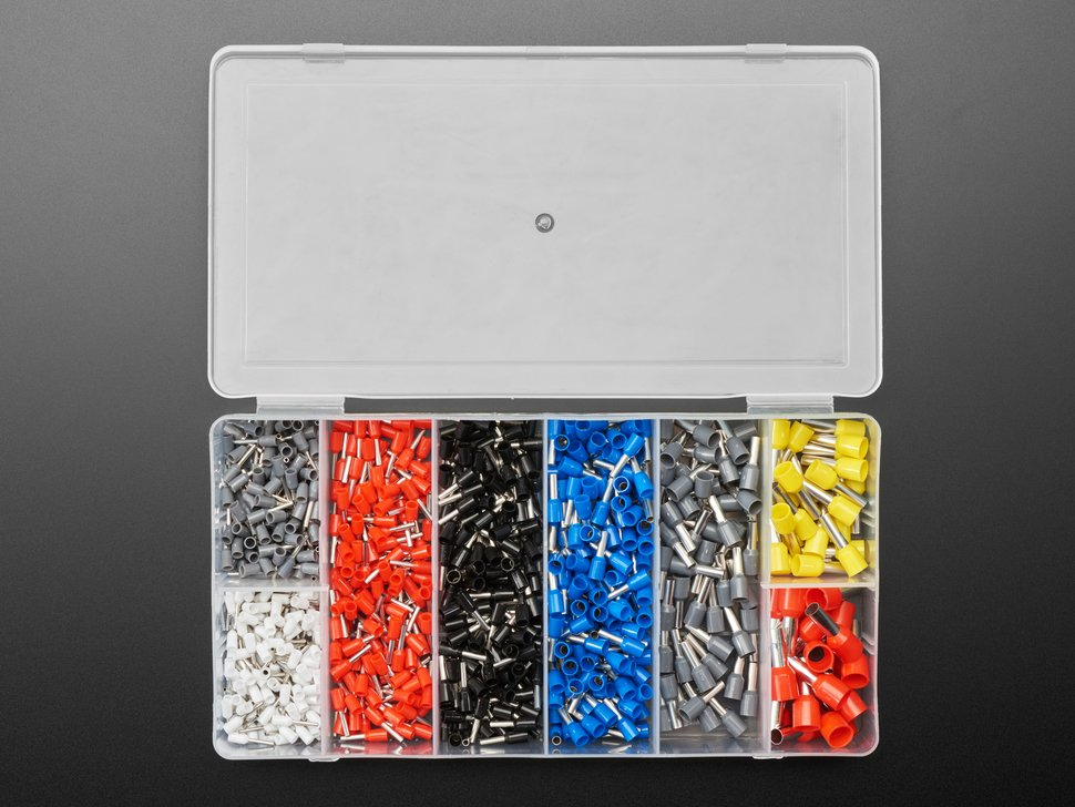 Top view of a clear plastic storage box opened up with several compartments of variously sized wire ferrules.