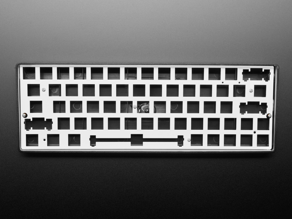 Top view of Silver Anodized Metal 60% / GH60 Keyboard Shell Plate assembled in a black keyboard enclosure.