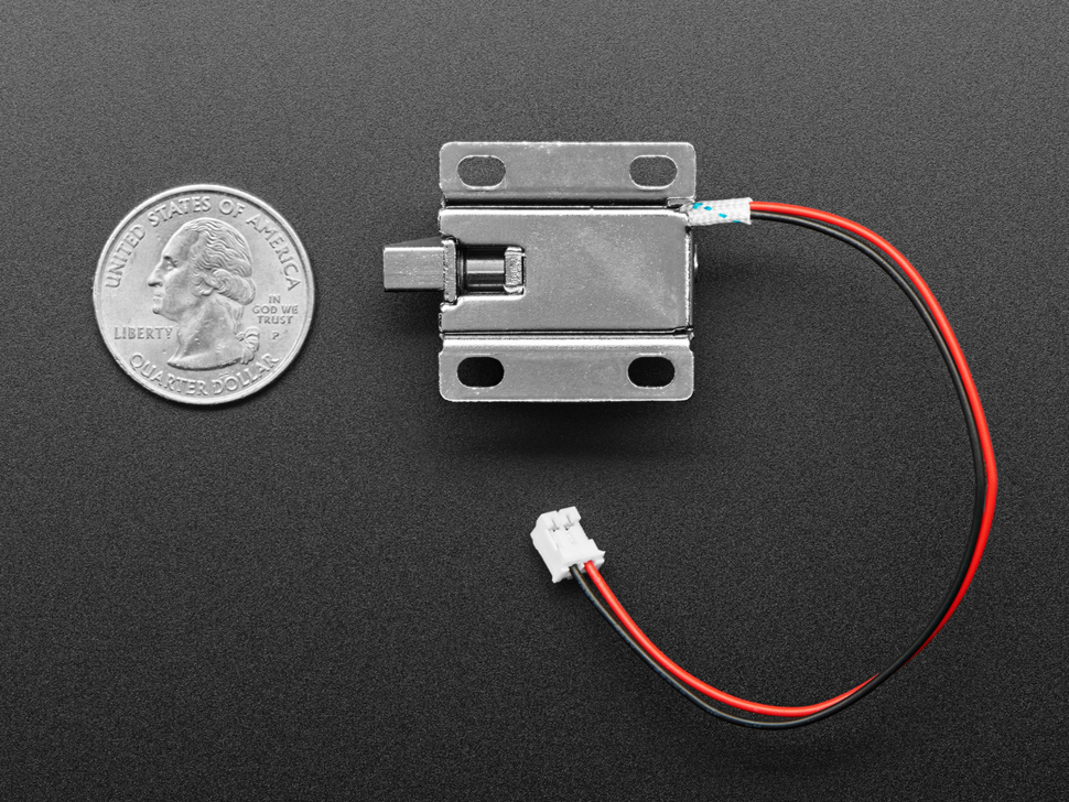 Bottom of Short Lock-style Solenoid next to US quarter for scale.