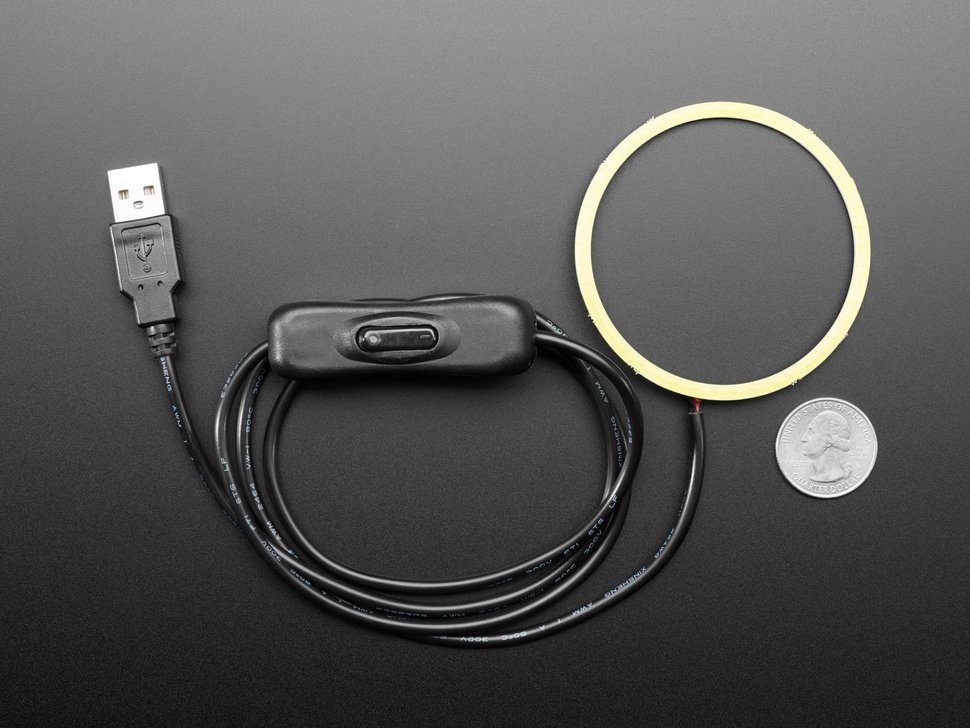 Top view of 5V COB Ring Light with black USB cable next to US quarter for scale.