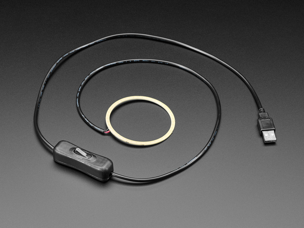 Angled shot of 5V COB Ring Light with black USB cable uncoiled.