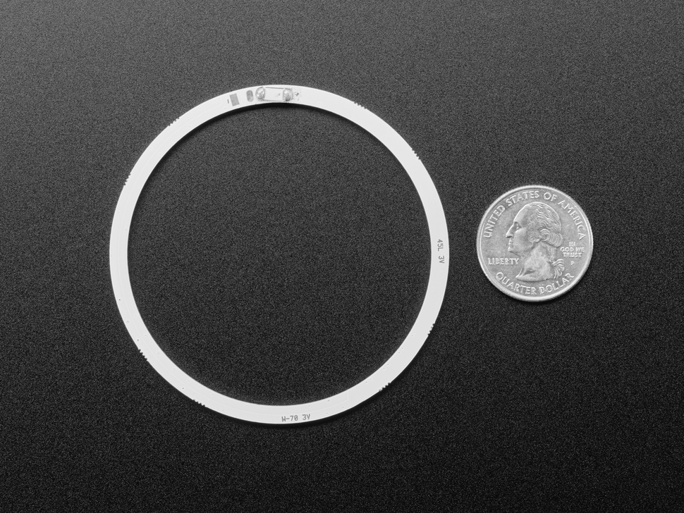 Back of COB ring light next to US quarter for scale.
