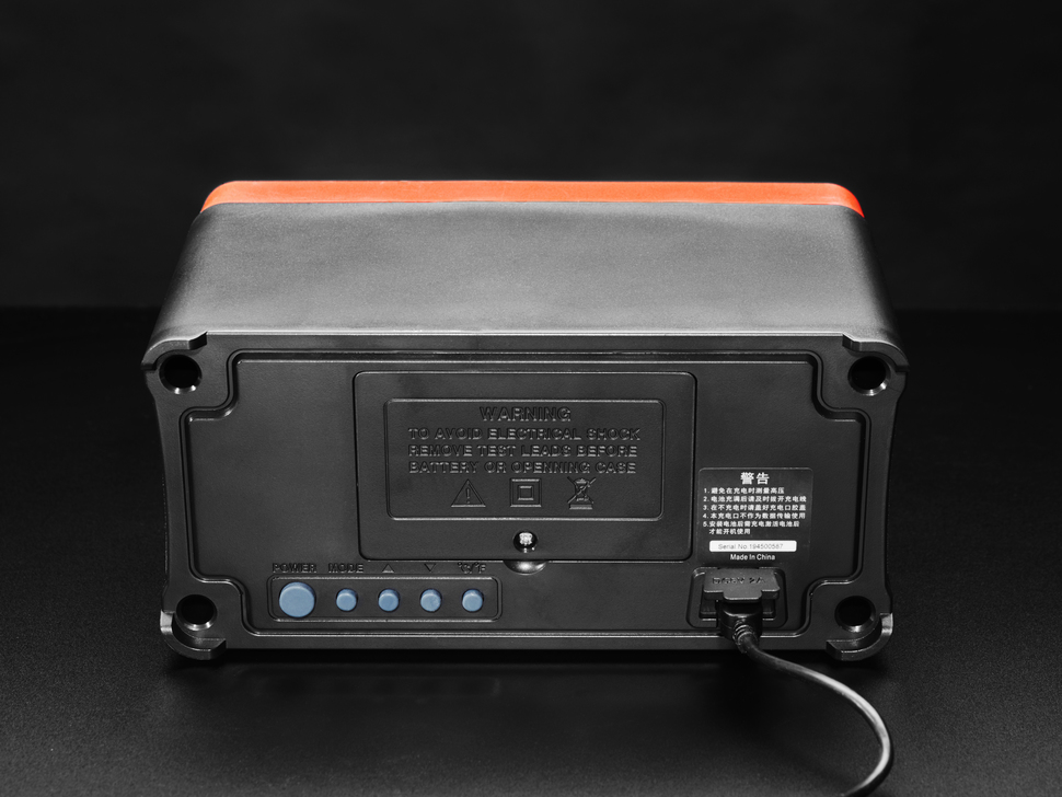 Back of digital multimeter with Bluetooth speaker.