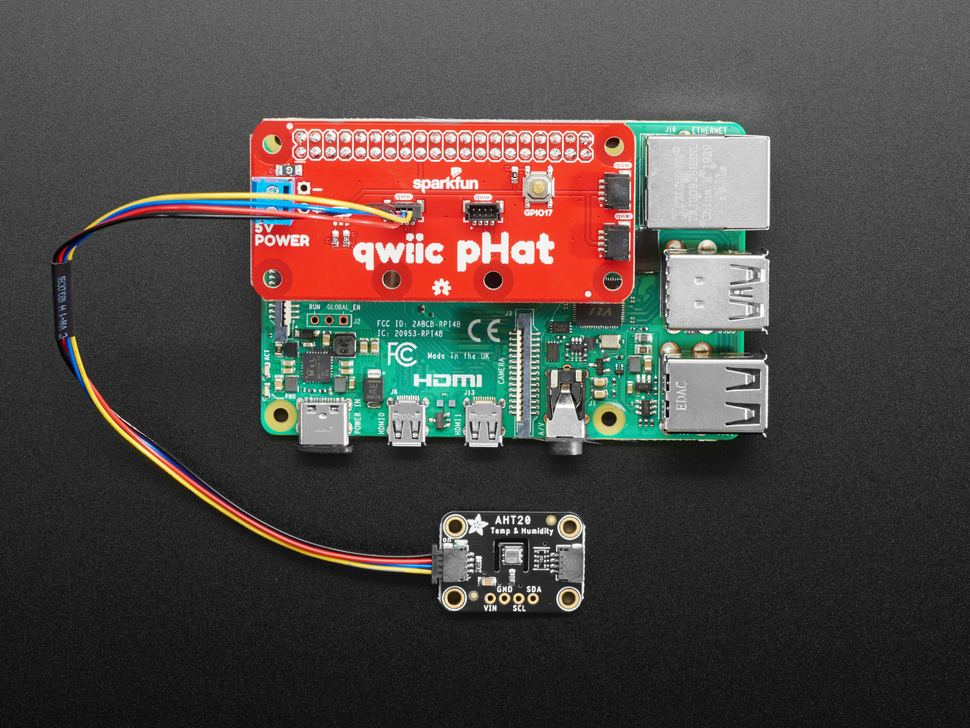 Top view of a Qwiic pHAT installed on a Pi 4 connected to a temperature-humidity sensor.