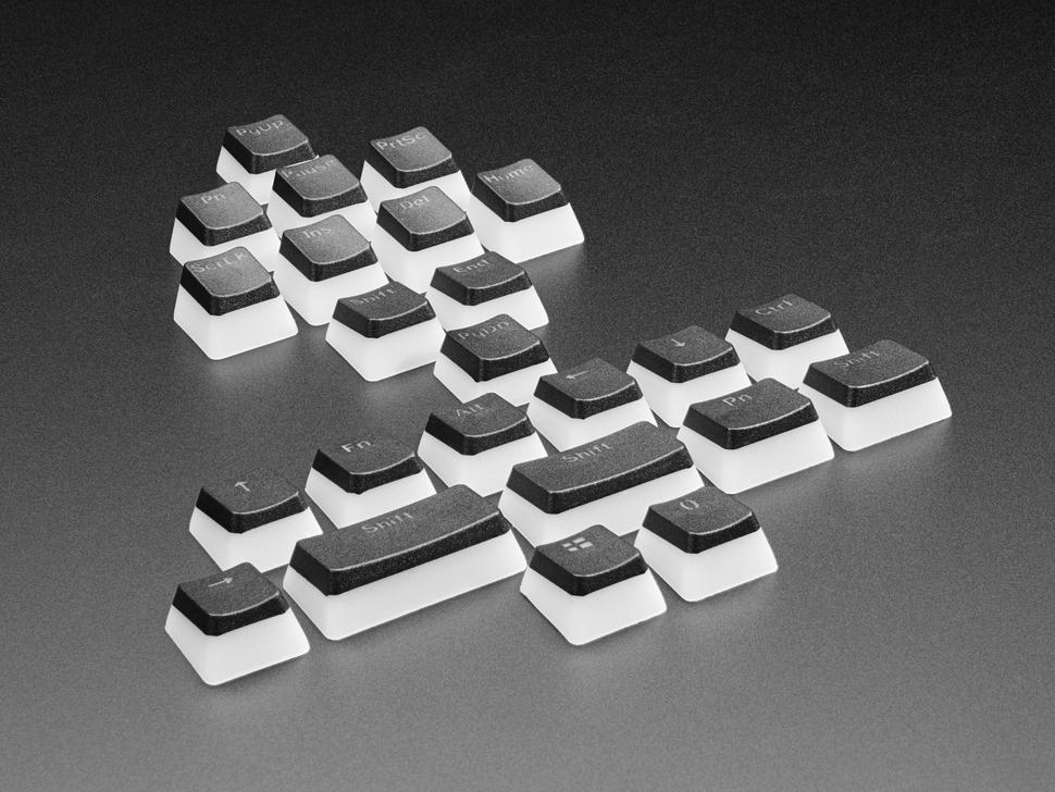 Angled shot of 24 black pudding keycaps.