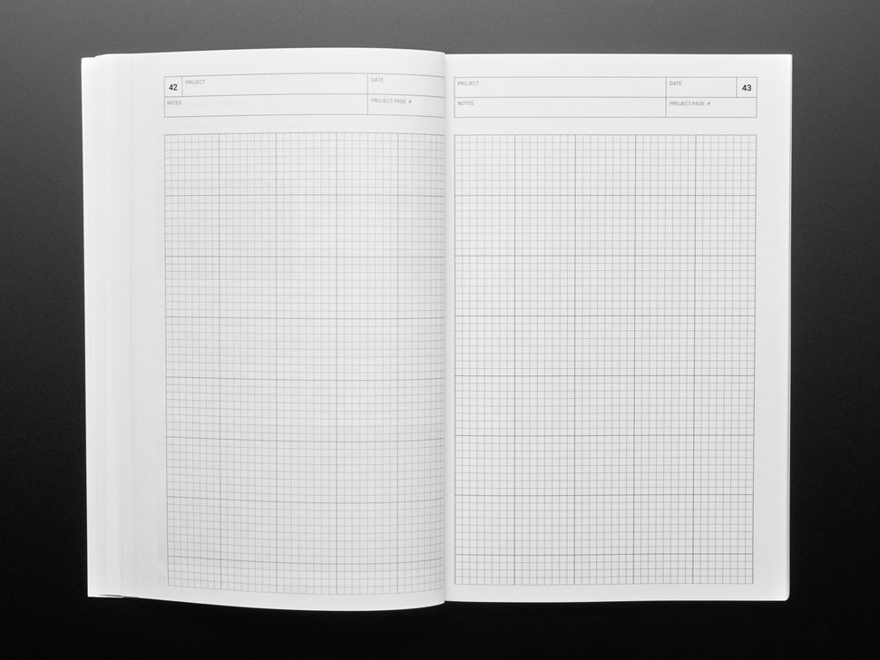 Opened handbook with blank grid pages.