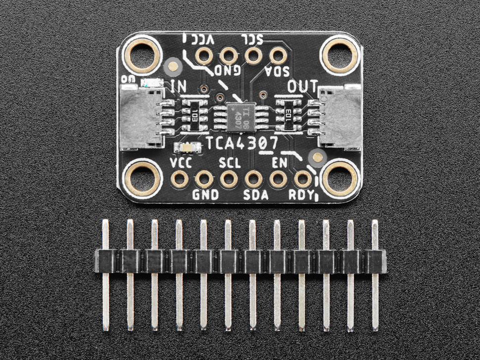 "Top view of Adafruit TCA4307 Hot-Swap I2C Buffer above a 12-pin 0.1"" male header."