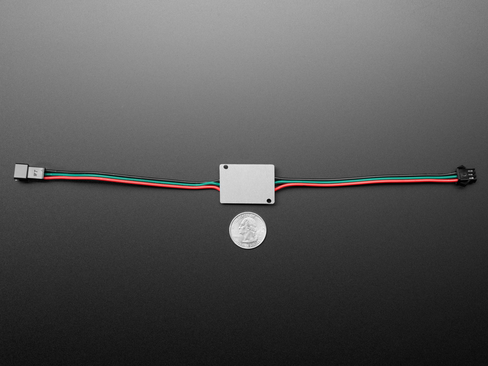 Bottom of Ultra Bright 4 Watt Chainable NeoPixel LED above a US quarter for scale.
