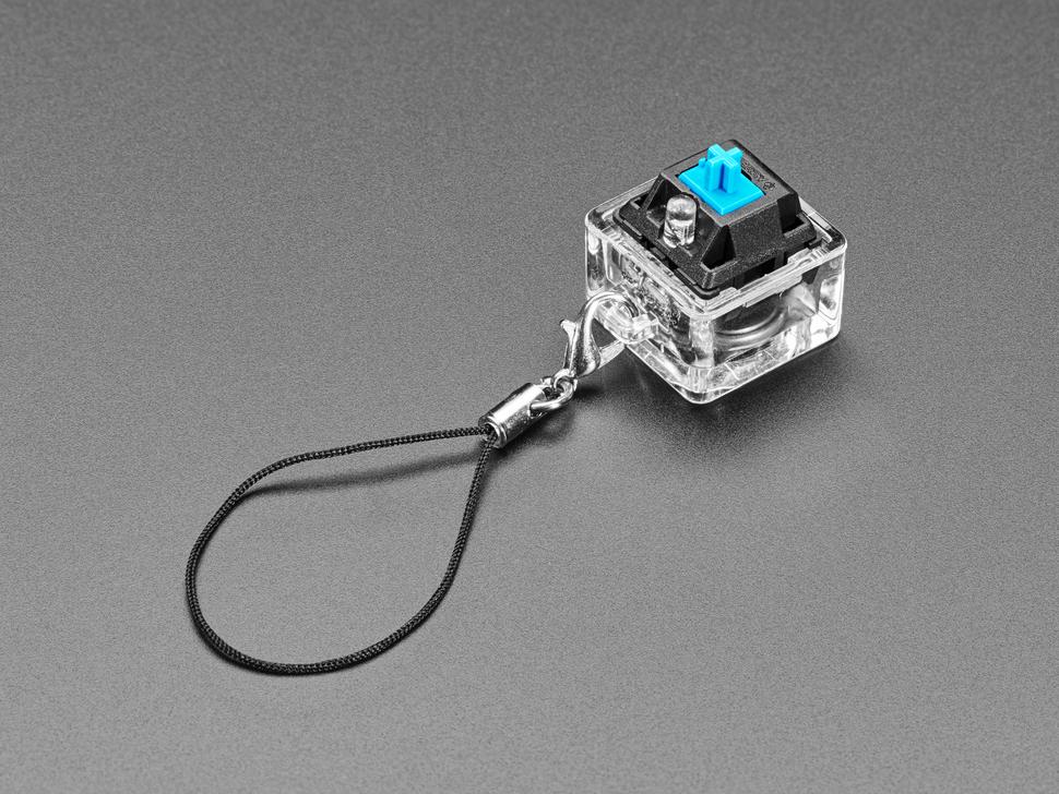 Angled shot of light-up keycap keychain.