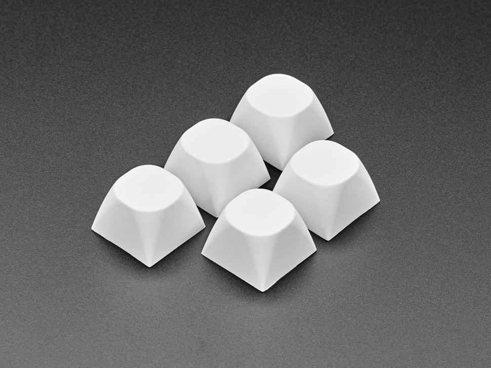 Angled shot of 5 white MA keycaps.