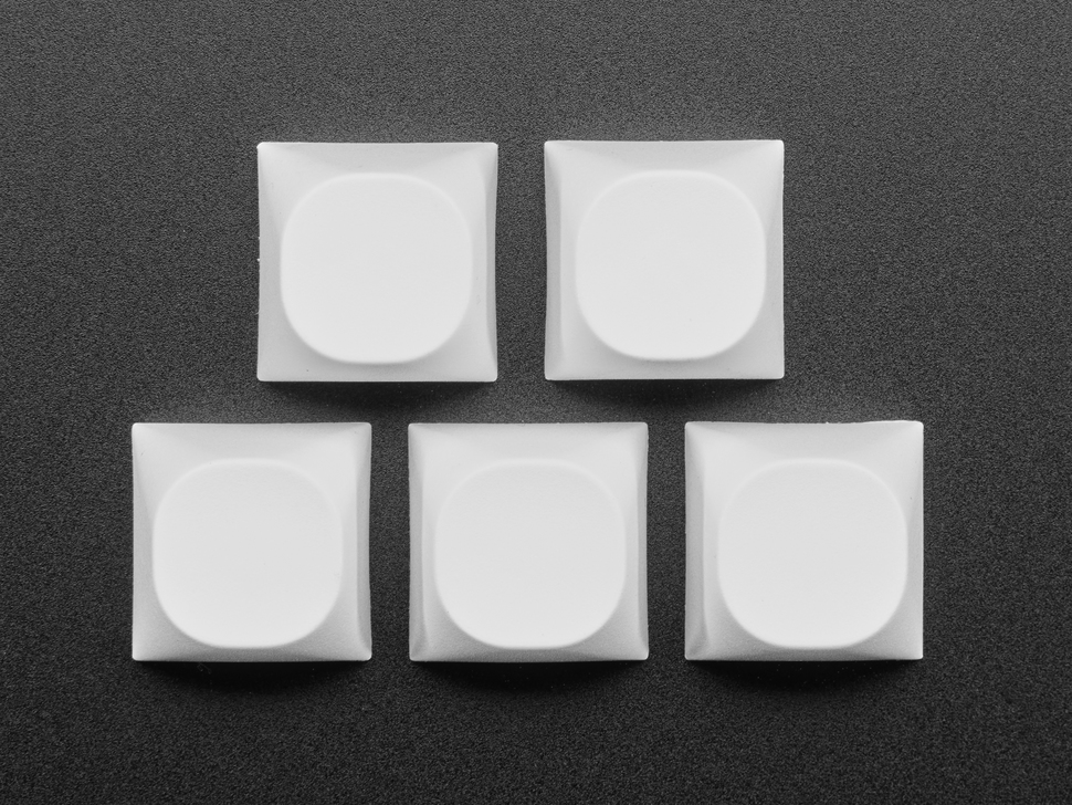 Top view of 10 white keycaps.