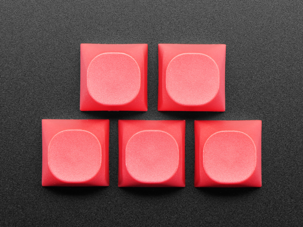 Top view of five Red MA keycaps.