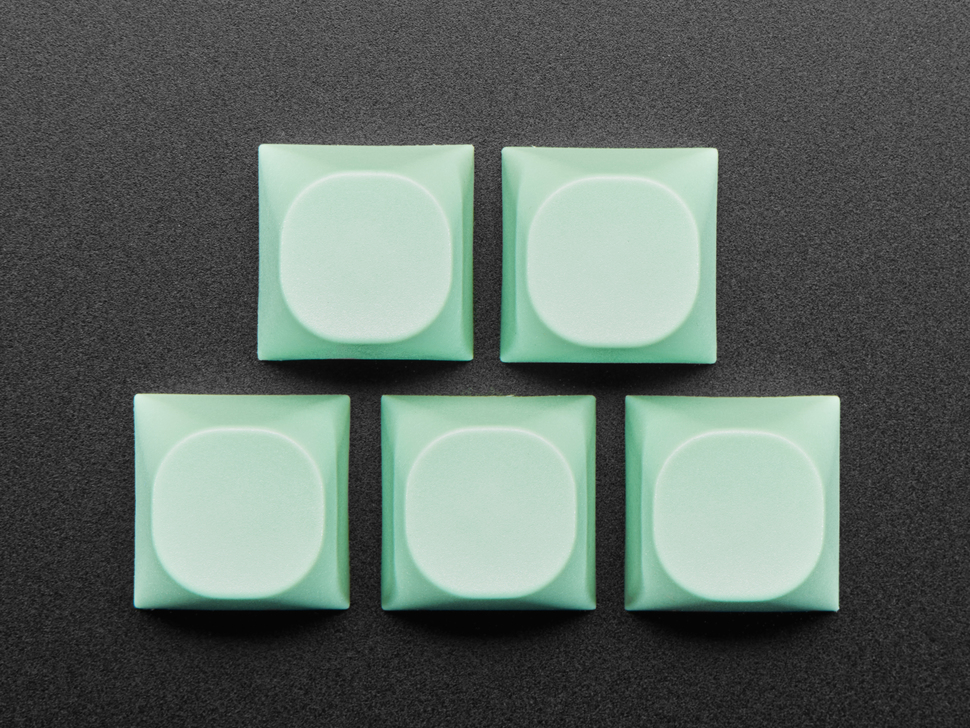 Top view of 10 mint screen MA keycaps.
