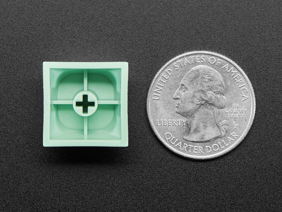Bottom of mint screen MA keycaps next to US quarter for scale.