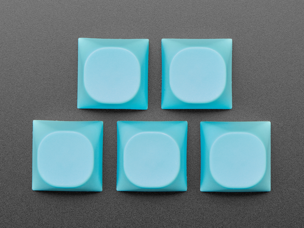 Top view of five cyan keycaps.