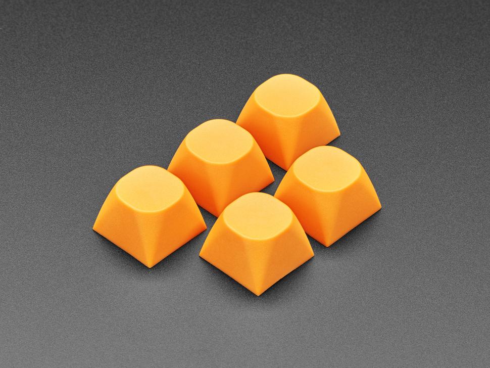Angled shot of five orange MA keycaps.