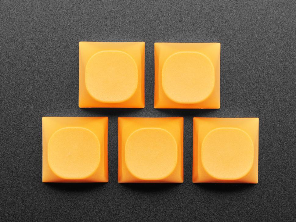 Top view of five orange MA keycap.