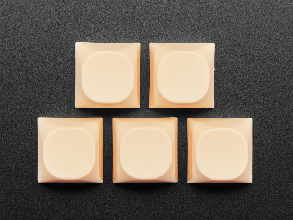 Top view of cream orange MA keycaps.