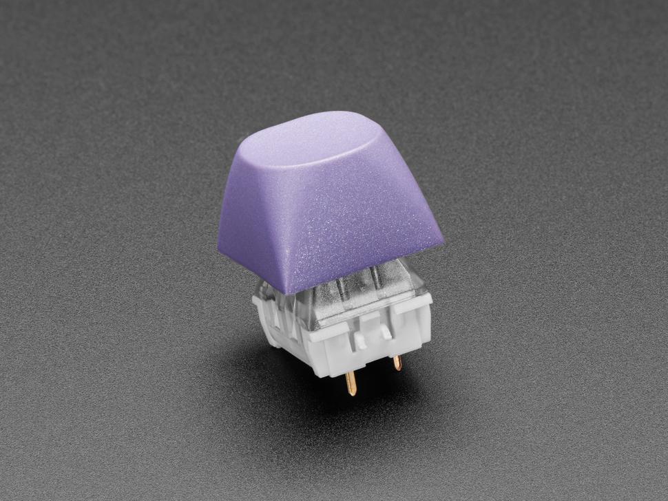 Single purple keycap on keyswitch.