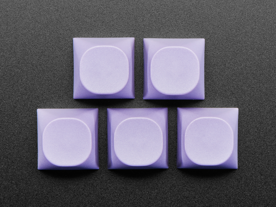 Top view of 5 purple keycaps.