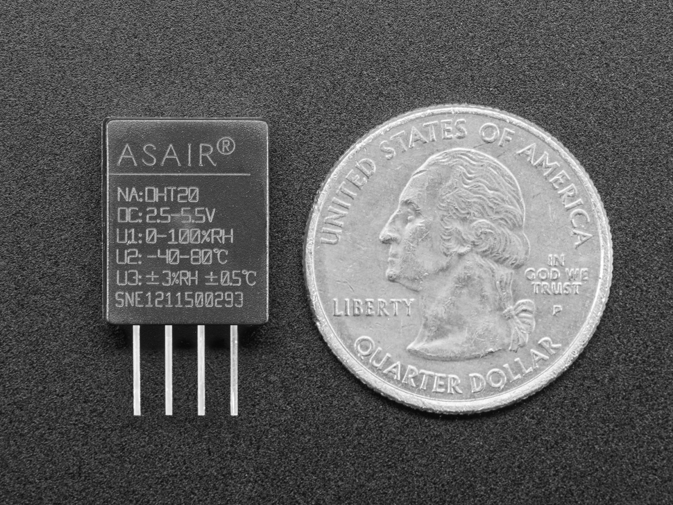 Bottom of AM2108 (Wired DHT20) - Digital Temperature and Humidity Sensor next to US quarter for scale.