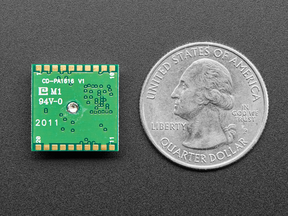 Bottom of Ultimate GPS module next to US quarter for scale.