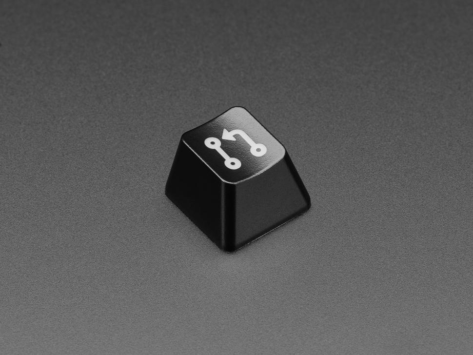 Angled shot of black Pull Req keycap.