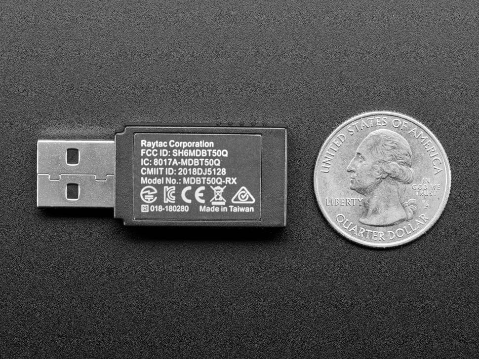 Bottom of Bluetooth USB key next to US quarter for scale.