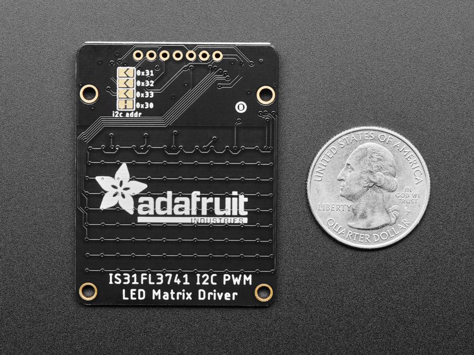 Back of Adafruit 13x9 PWM RGB LED Matrix Driver PCB next to US quarter for scale.