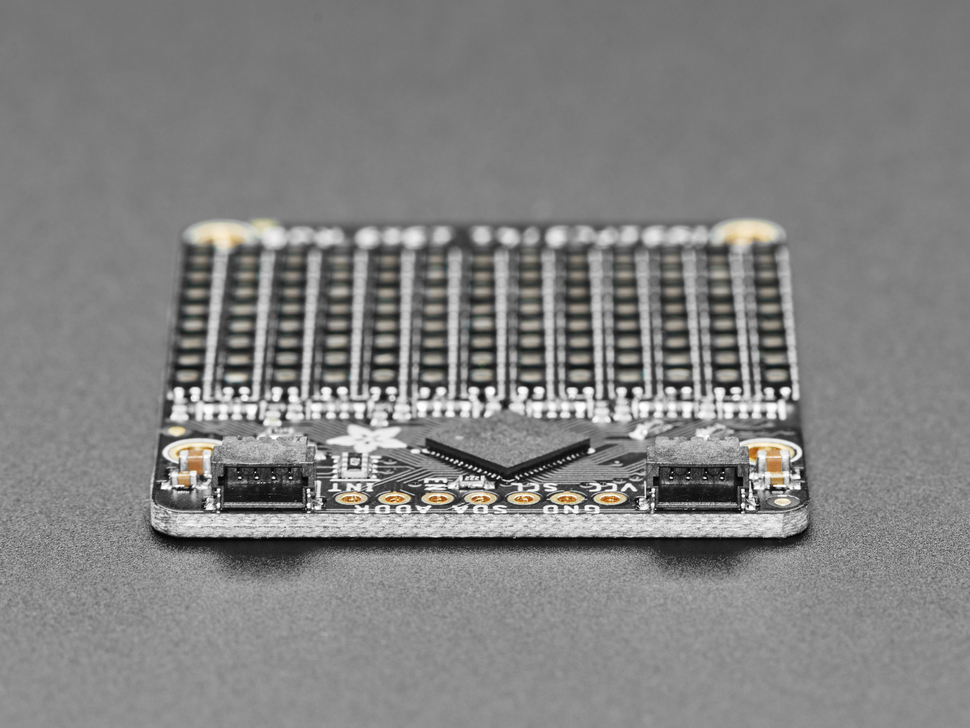 Close-up of STEMMA QT connectors on Adafruit 13x9 PWM RGB LED Matrix Driver.
