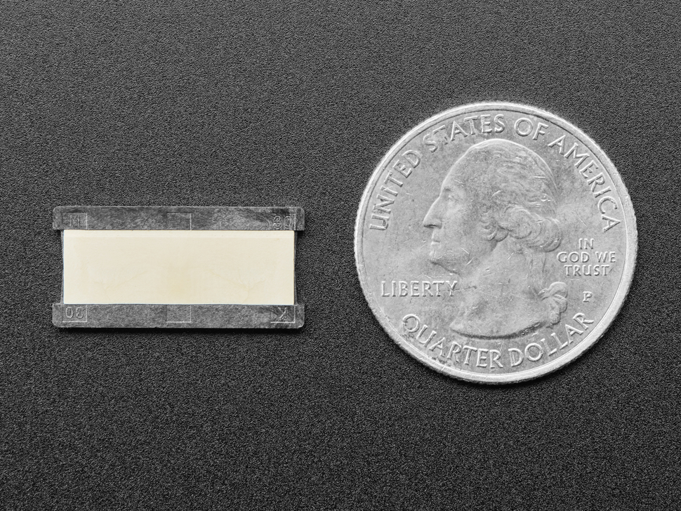 Bottom of 30-pin 0.5mm FFC / FPC Extender next to US quarter for scale.