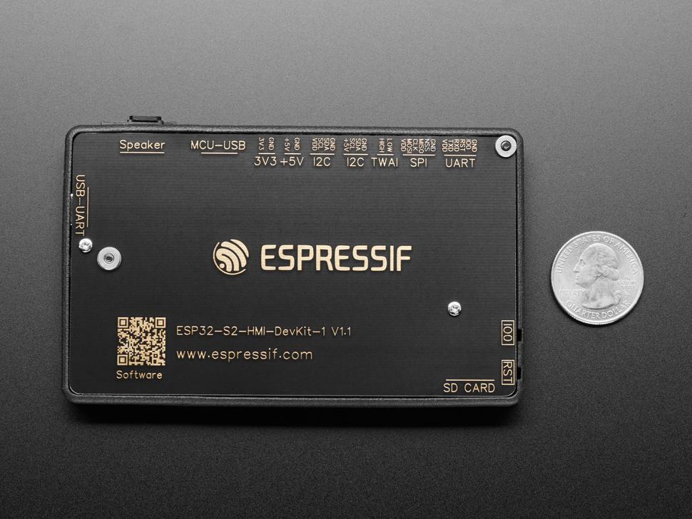 Back of ESP32-S2-HMI-DevKit-1 PCB next to US quarter for scale.