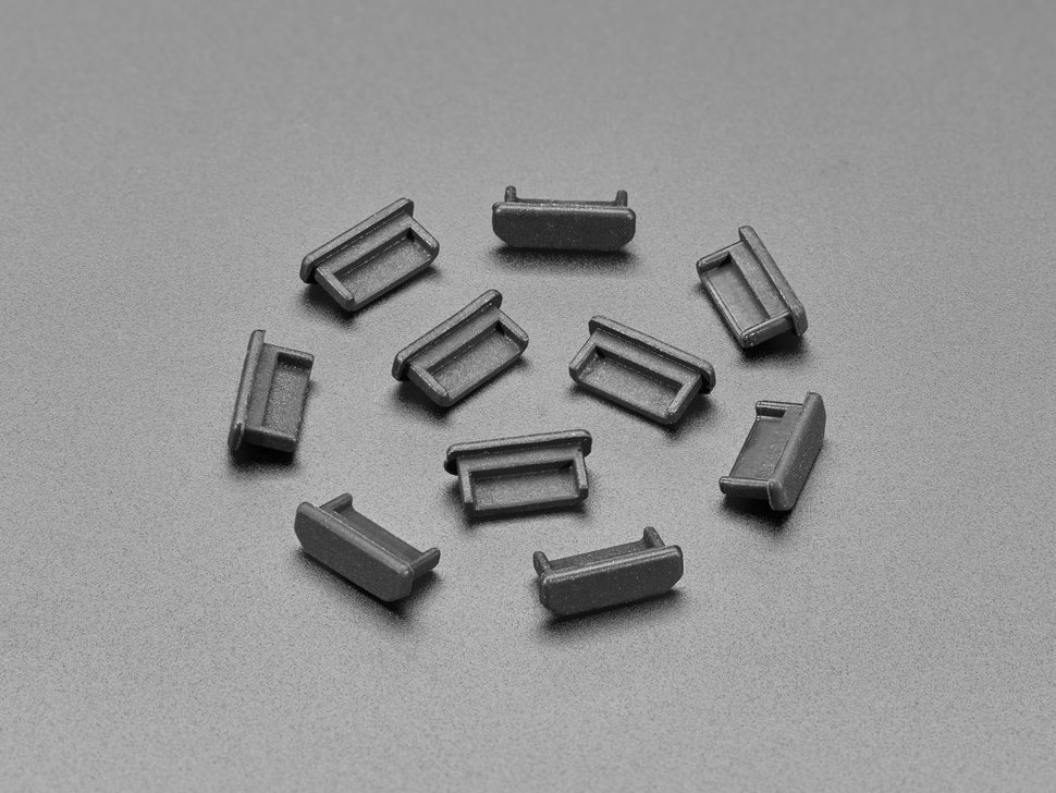Angled shot of 10 black silicone mini HDMI dust covers.