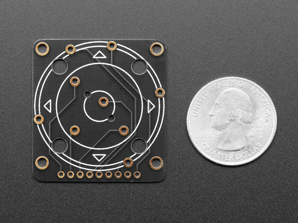 Back of Rotary Navigation Encoder Breakout next to US quarter for scale.