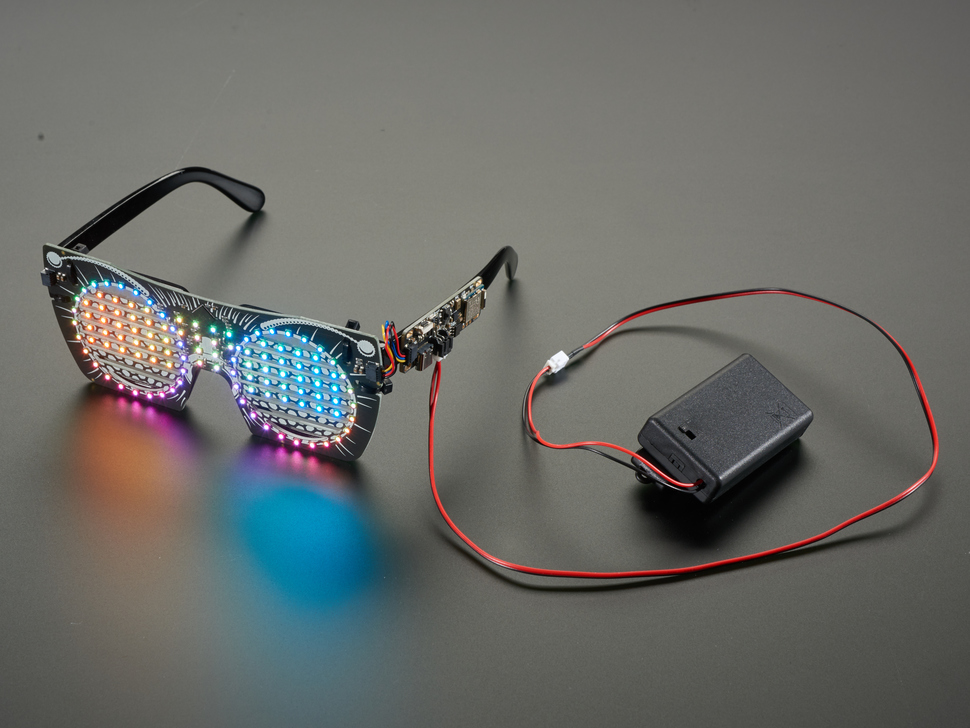 Angled shot of powered on and assembled LED glasses.